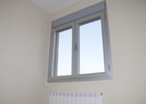 Aluminum window installed over a radiator