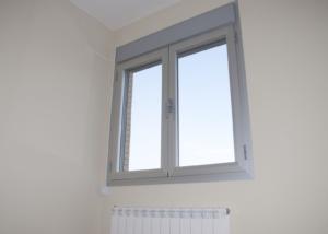 Aluminum window installed over a radiator